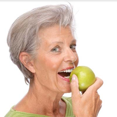 Bite any hard foods with denture implants. You can even bite an apple!