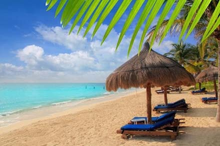 Beach in Cancun Mexico where you can relax after your dental implant vacations